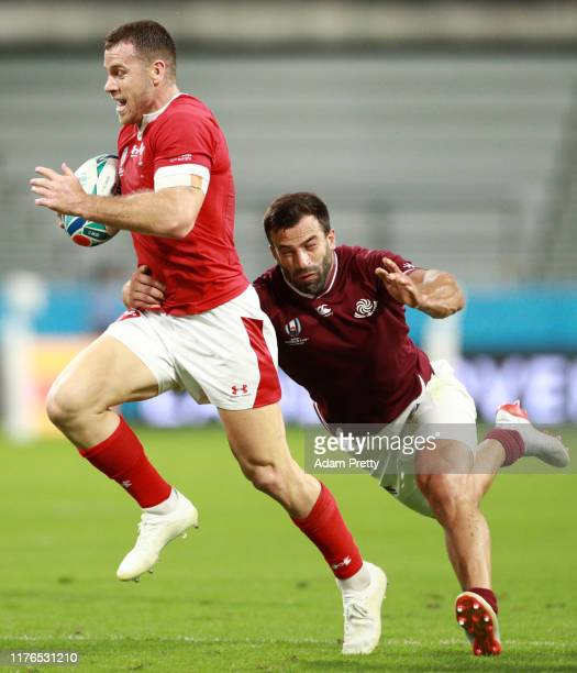 Gareth Davies of Wales is tackled by David Kacharava of Georgia during the Rugby World Cup 2019 Group D game between Wales and Georgia at City of...