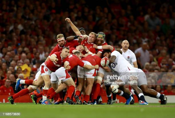 Gareth Davies of Wales passes the ball out from the scrum during the Under Armour Summer Series match between Wales and England at Principality...