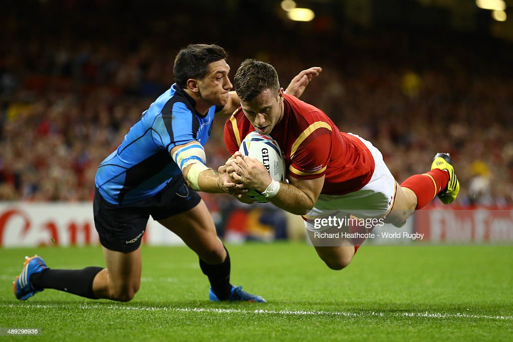 Gareth Davies of Wales scores his teams sixth try during the 2015 Rugby World Cup Pool A match between Wales and Uruguay at the Millennium Stadium on September 20, 2015 in Cardiff, United Kingdom.