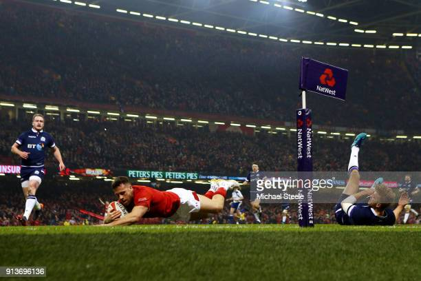 Gareth Davies of Wales touches down for the first try during the Natwest Six Nations round One match between Wales and Scotland at Principality...