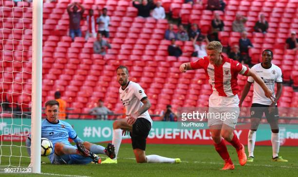 Gareth Dean of Brackley Town scores his sides equalising goal to make the score 11 during The Buildbase FA Trophy Final match between Brackley Town...