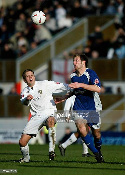 Gareth Edds of Milton Keynes battles with Sam Parkin of Swindon during the Coca-Cola League One match between Milton Keynes Dons and Swindon Town at...