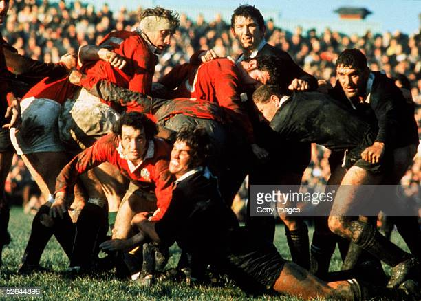 Gareth Edwards of the British Lions is tackled by New Zealand's Alan McNaughton during a test match on the British Lions Tour to New Zealand in 1971