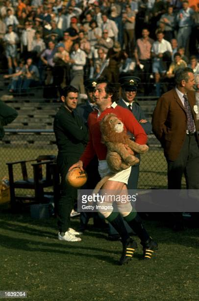 Gareth Edwards of the British Lions runs out with the Lion's mascot during the Rugby Lions tour of South Africa South Africa Mandatory Credit...