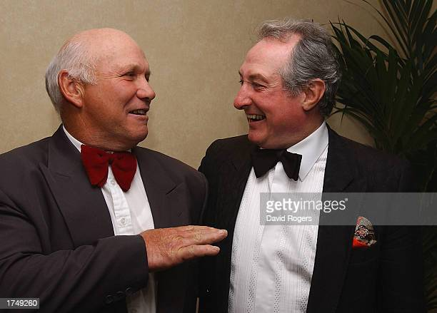 Gareth Edwards the Barbarian scrumhalf chats to his opposite number Sid Going during the reunion party for the 1973 Barbarians held at the Hilton...