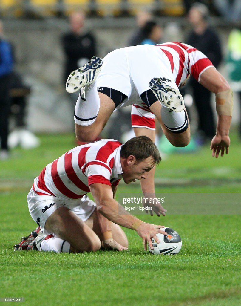 Gareth Ellis of England flies over teammate James Roby during the Four Nations match between the New Zealand Kiwis and England at Westpac Stadium on October 23, 2010 in Wellington, New Zealand.