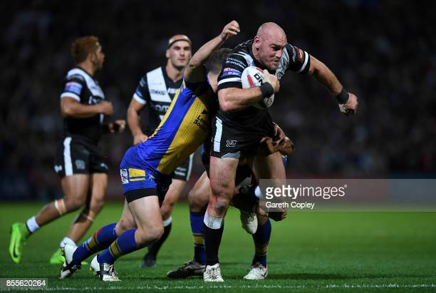 Gareth Ellis of Hull FC is tackled by Danny McGuire of Leeds during the Betfred Super League semi final between Leeds Rhinos and Hull FC at...