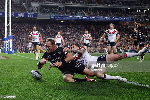 Gareth Ellis of the Tigers drops the ball over the line during the NRL Second Qualifying Final match between the Wests Tigers and the Sydney Roosters...