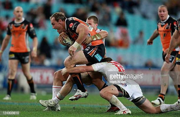 Gareth Ellis of the Tigers is tackled during the NRL 1st Qualifying Final match between the Wests Tigers and the St George Illawarra Dragons at ANZ...