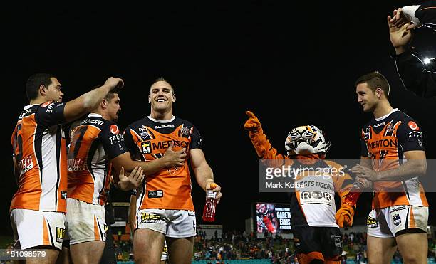 Gareth Ellis of the Tigers leaves the field through a guard of honour after his last match during the round 26 NRL match between the Wests Tigers and...