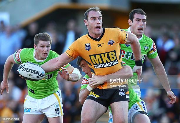 Gareth Ellis of the Tigers looks to offload during the round 15 NRL match between the Wests Tigers and the Canberra Raiders at Leichhardt Oval on...