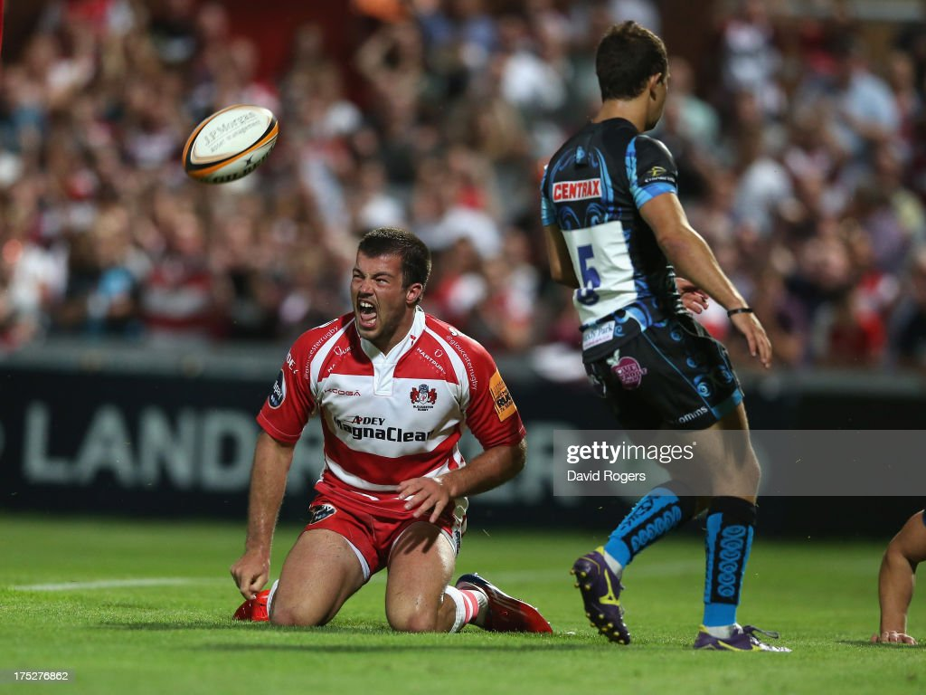 Gareth Evans of Gloucester celebrates after scoring a try against Exeter Chiefs during the J.P. Morgan Asset Management Premiership Rugby 7's held at Kingsholm Stadium on August 1, 2013 in Gloucester, England.