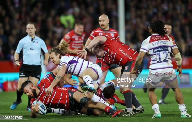 Gareth Evans of Gloucester is tackled by Sam Harrison of Leicester Tigers during the Gallagher Premiership Rugby match between Gloucester Rugby and...