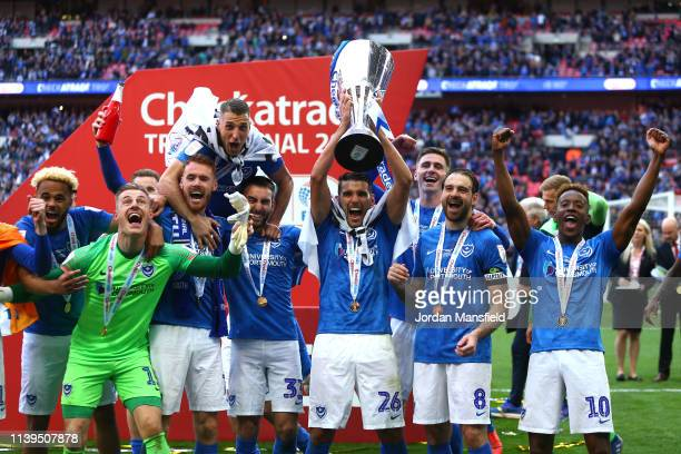 Gareth Evans of Portsmouth and team mates celebrate with the trophy following victory during the Checkatrade Trophy Final between Portsmouth and...