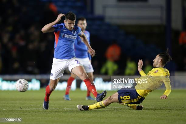 Gareth Evans of Portsmouth FC competes for the ball with Dani Ceballos of Arsenal during the FA Cup Fifth Round match between Portsmouth FC and...
