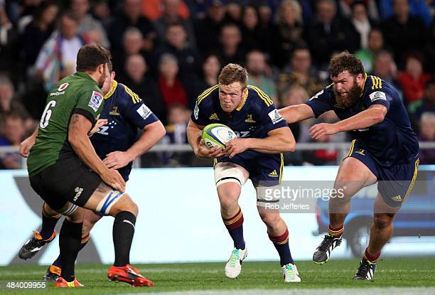 Gareth evans of the Highlanders on the charge with the support of Liam Coltman during the round nine Super Rugby match between the Highlanders and...