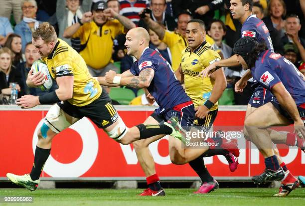 Gareth Evans the Hurricanes dives to score a try during the round seven Super Rugby match between the Rebels and the Hurricanes at AAMI Park on March...