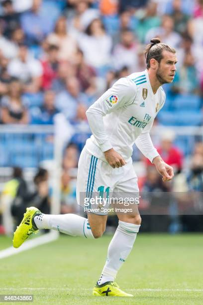 Gareth Frank Bale of Real Madrid substitutes Karim Benzema of Real Madrid during the La Liga match between Real Madrid and Levante UD at the Estadio...