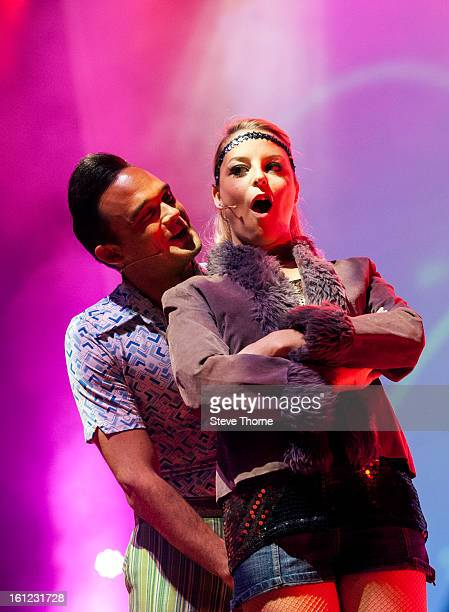 Gareth Gates and a member of the cast perform on stage as part of Boogie Nights at Symphony Hall on February 9 2013 in Birmingham England