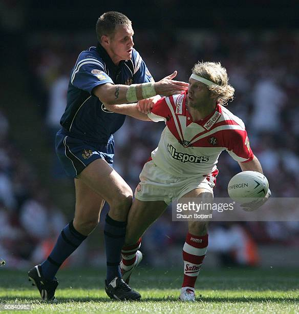Gareth Hock of Wigan Warriors tries to tackle Sean Long of St. Helens during the Powergen Challenge Cup Final match between St. Helens and Wigan...