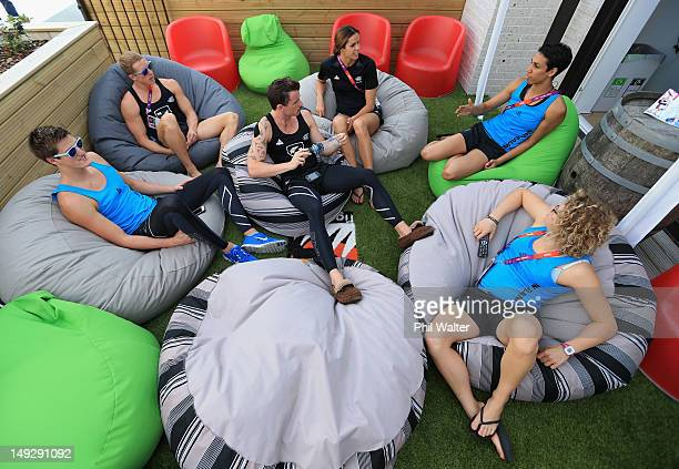 Gareth Kean, Steven Kent, Daniel Bell, Penelope Marshall, Alexis Pritchard and Natalie Wiegersma of New Zealand relax in their residence inside the...