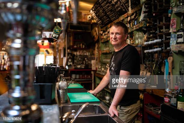 Gareth Kerr the owner of Cafe Kick is seen within the closed sports bar on April 24 2020 in London England The bar has been closed since the...