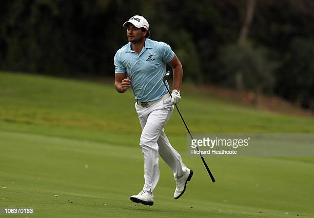 Gareth Maybin of Northern Ireland runs up the 16th fairway after hitting his approach shot to the green during the third round of the Andalucia...