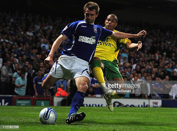 Gareth McAuley of Ipswich Town battles with Simeon Jackson of Norwich City during the npower Championship match between Ipswich Town and Norwich City...