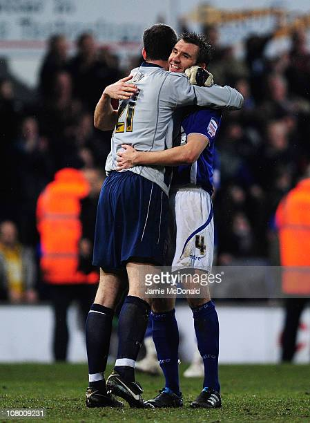 Gareth McAuley of Ipswich Town celebrates victory with goalkeeper Marton Fulop during the Carling Cup Semi Final First Leg match between Ipswich Town...