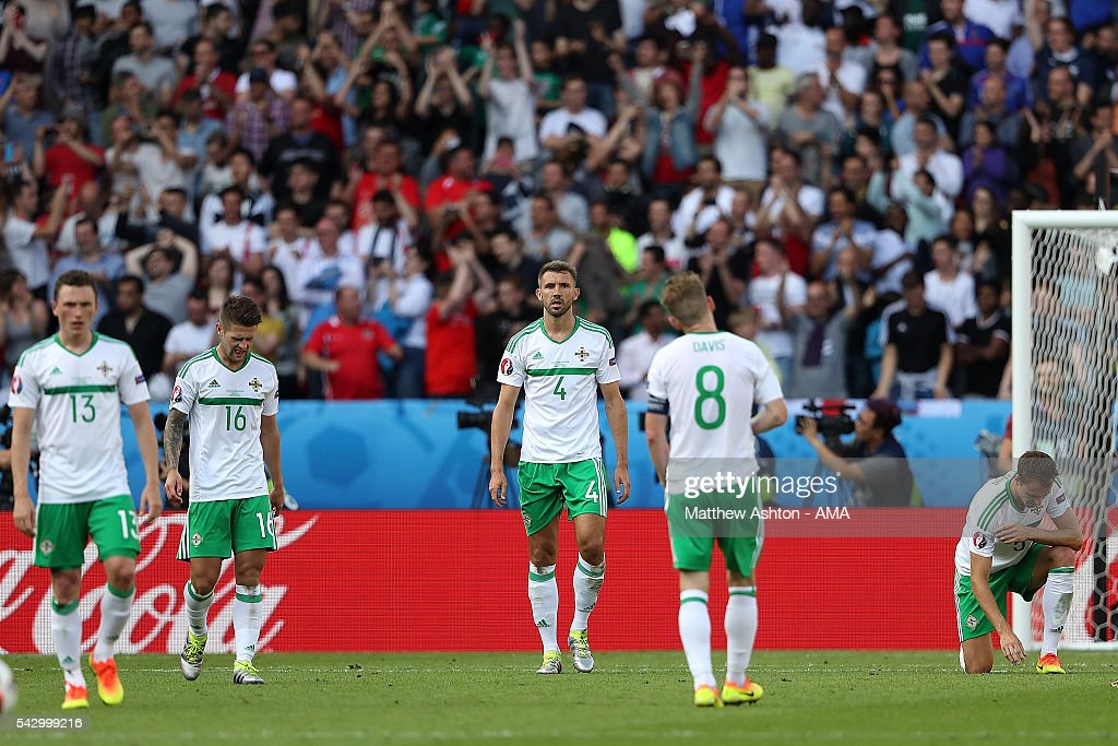 Gareth McAuley of Northern Ireland and his team-mates react after he scored an own goal to make the score 1-0 during the UEFA Euro 2016 Round of 16 match between Wales and Northern Ireland at Parc des Princes on June 25, 2016 in Paris, France.