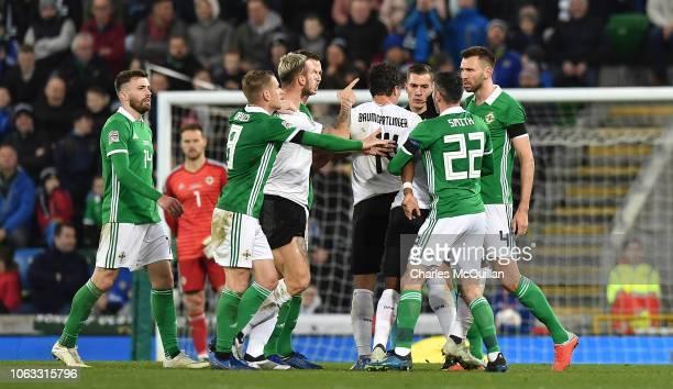 Gareth McAuley of Northern Ireland and Marko Arnautovic of Austria clash during the UEFA Nations League B group three match between Northern Ireland...