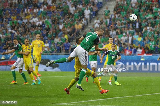 Gareth McAuley of Northern Ireland heads the ball to score his team's first goal during the UEFA EURO 2016 Group C match between Ukraine and Northern...