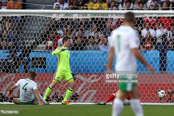 Gareth McAuley of Northern Ireland scores an own goal to make the score 10 during the UEFA Euro 2016 Round of 16 match between Wales and Northern...