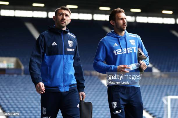 Gareth McAuley of West Bromwich Albion and Craig Dawson of West Bromwich Albion arrive at the stadium prior to during the Premier League match...