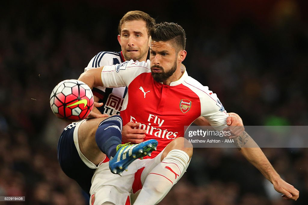 Gareth McAuley of West Bromwich Albion and Olivier Giroud of Arsenal compete during the Barclays Premier League match between Arsenal and West Bromwich Albion at the Emirates Stadium, on April 21, 2016 in London, England.