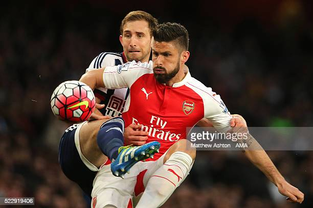Gareth McAuley of West Bromwich Albion and Olivier Giroud of Arsenal compete during the Barclays Premier League match between Arsenal and West...