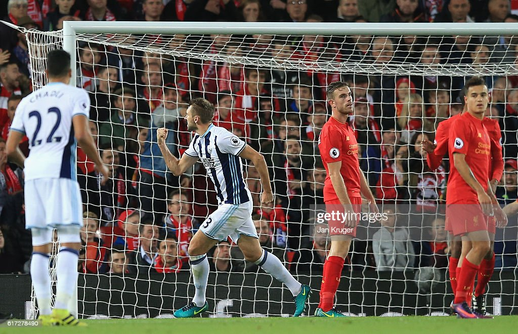 Gareth McAuley (2nd L) of West Bromwich Albion celebrates after scoring a goal during the Premier League match between Liverpool and West Bromwich Albion at Anfield on October 22, 2016 in Liverpool, England.