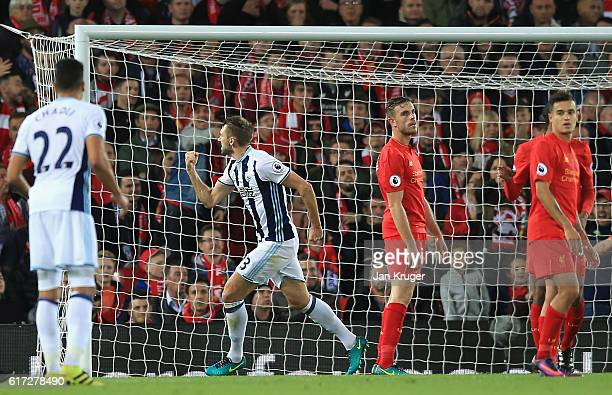Gareth McAuley of West Bromwich Albion celebrates after scoring a goal during the Premier League match between Liverpool and West Bromwich Albion at...