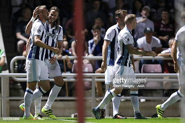 Gareth McAuley of West Bromwich Albion celebrates after scoring a goal to make it 12 during the EFL Cup fixture between Northampton Town and West...
