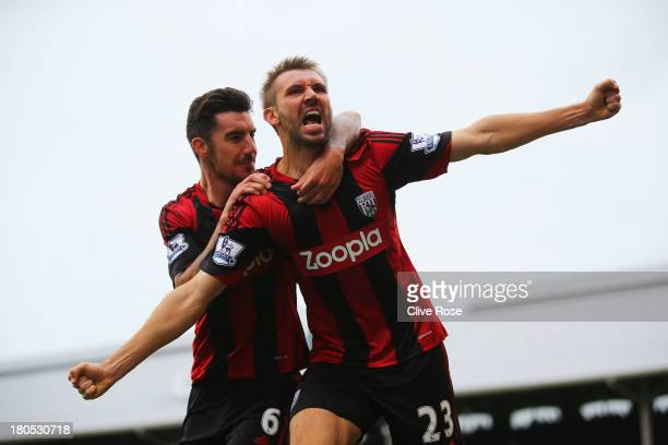 Gareth McAuley of West Bromwich Albion celebrates his goal with Liam Ridgewell during the Barclays Premier League match between Fulham and West...