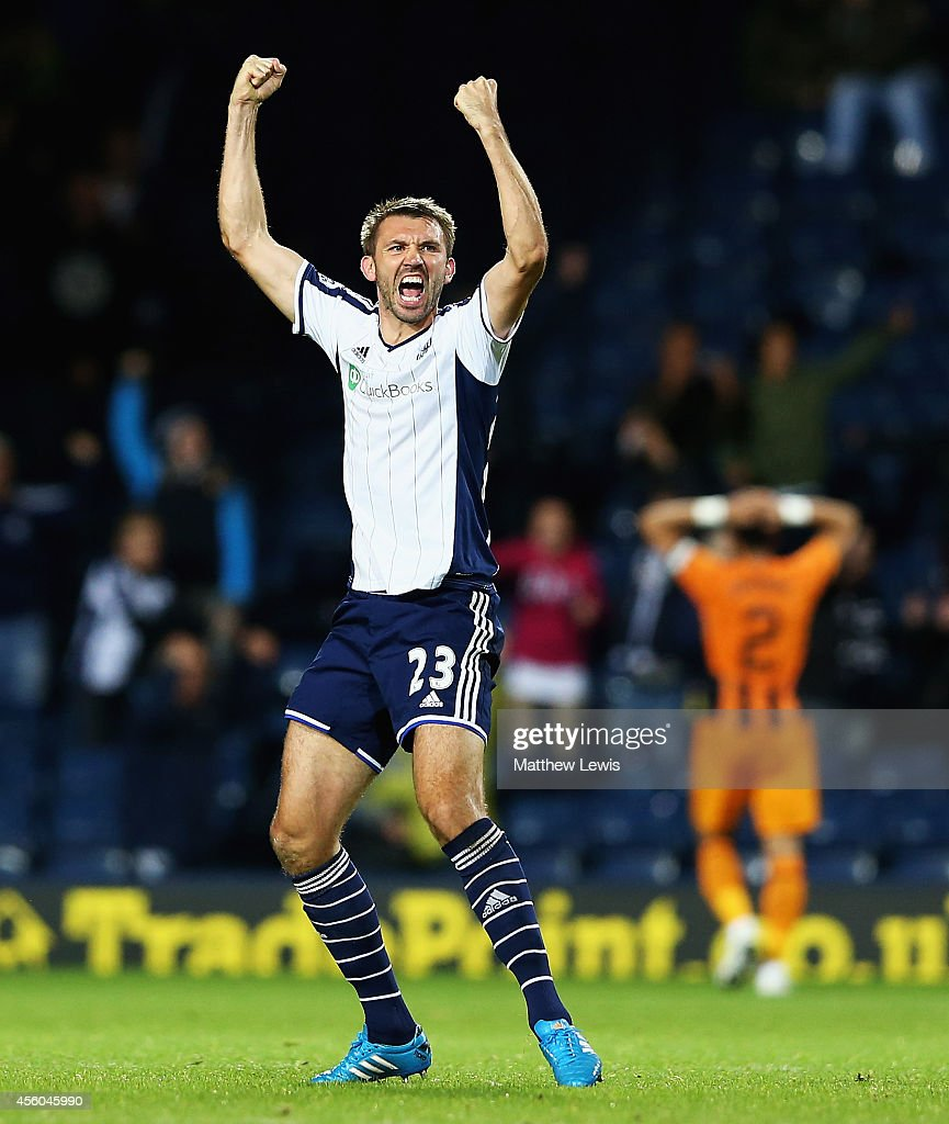 Gareth McAuley of West Bromwich Albion celebrates his teams win during the Capital One Cup Third Round match between West Bromwich Albion and Hull City at The Hawthorns on September 24, 2014 in West Bromwich, England.