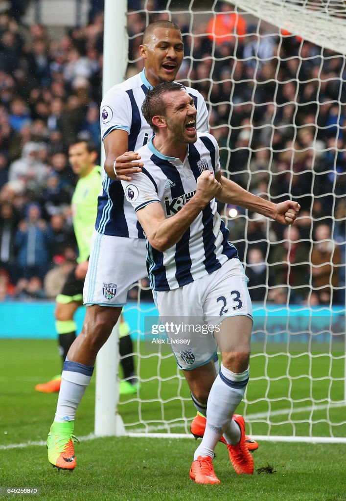 Gareth McAuley of West Bromwich Albion (R) celebrates scoring his sides second goal with Jose Salomon Rondon of West Bromwich Albion (L) during the Premier League match between West Bromwich Albion and AFC Bournemouth at The Hawthorns on February 25, 2017 in West Bromwich, England.
