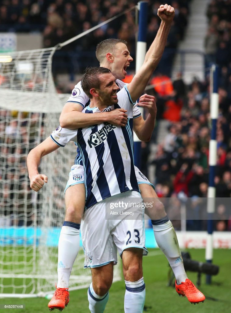 Gareth McAuley of West Bromwich Albion celebrates scoring his sides first goal with his West Bromwich Albion team mates during the Premier League match between West Bromwich Albion and AFC Bournemouth at The Hawthorns on February 25, 2017 in West Bromwich, England.
