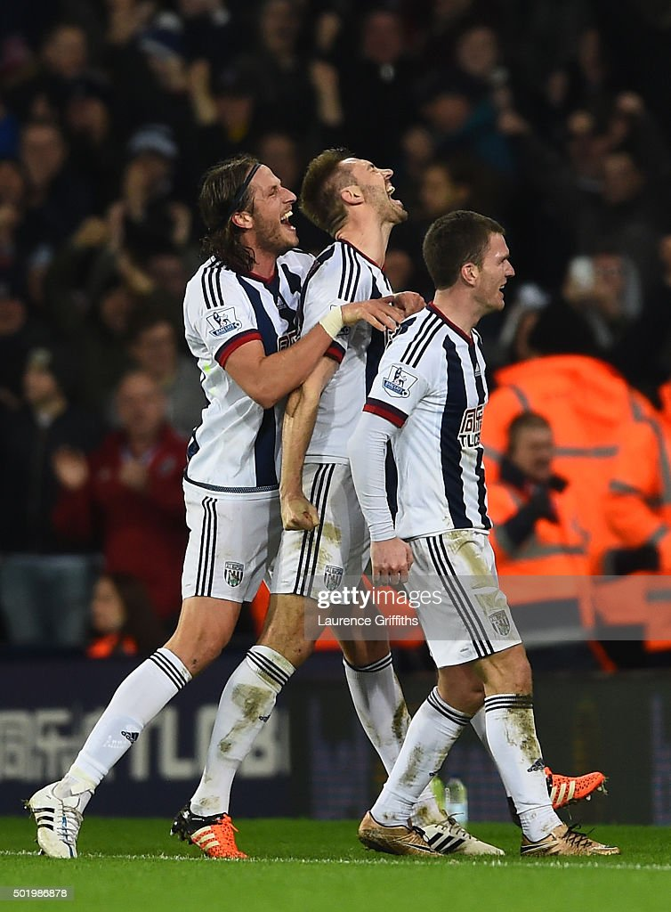 Gareth McAuley (C) of West Bromwich Albion celebrates scoring his team's first goal with his team mate Jonas Olsson (L) and Craig Gardner (R)during the Barclays Premier League match between West Bromwich Albion and A.F.C. Bournemouth at The Hawthorns on December 19, 2015 in West Bromwich, England.