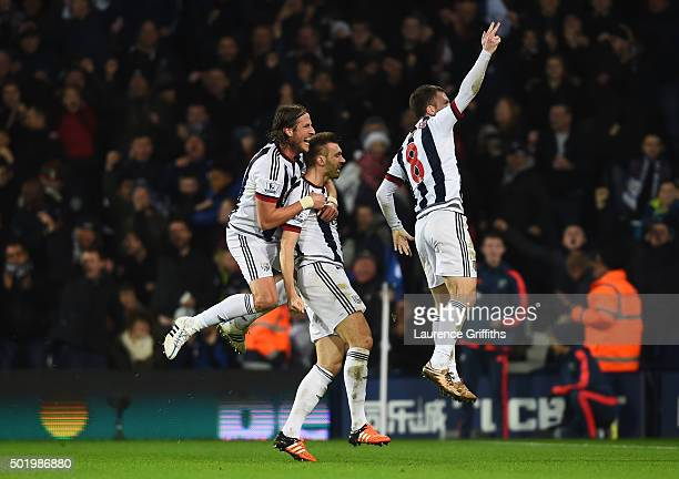 Gareth McAuley of West Bromwich Albion celebrates scoring his team's first goal with his team mate Jonas Olsson and Craig Gardner during the Barclays...
