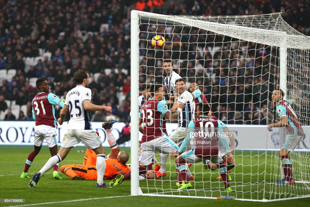 Gareth McAuley (C) of West Bromwich Albion heads to score his side's second goal to make it 2-2 during the Premier League match between West Ham United and West Bromwich Albion at London Stadium on February 11, 2017 in Stratford, England.