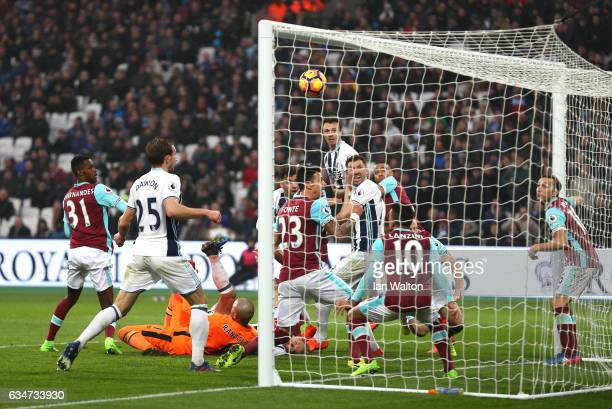 Gareth McAuley of West Bromwich Albion heads to score his side's second goal to make it 22 during the Premier League match between West Ham United...