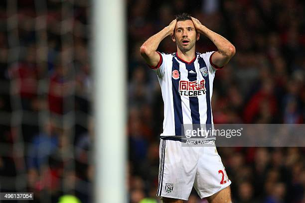 Gareth McAuley of West Bromwich Albion reacts after fouling Anthony Martial of Manchester United in the penalty area during the Barclays Premier...