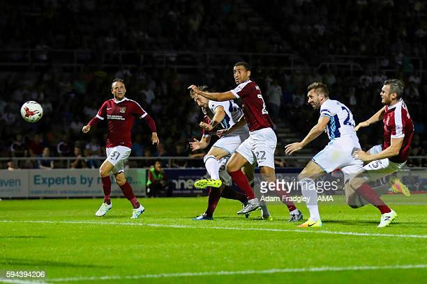 Gareth McAuley of West Bromwich Albion scores a goal to make it 12 during the EFL Cup fixture between Northampton Town and West Bromwich Albion at...
