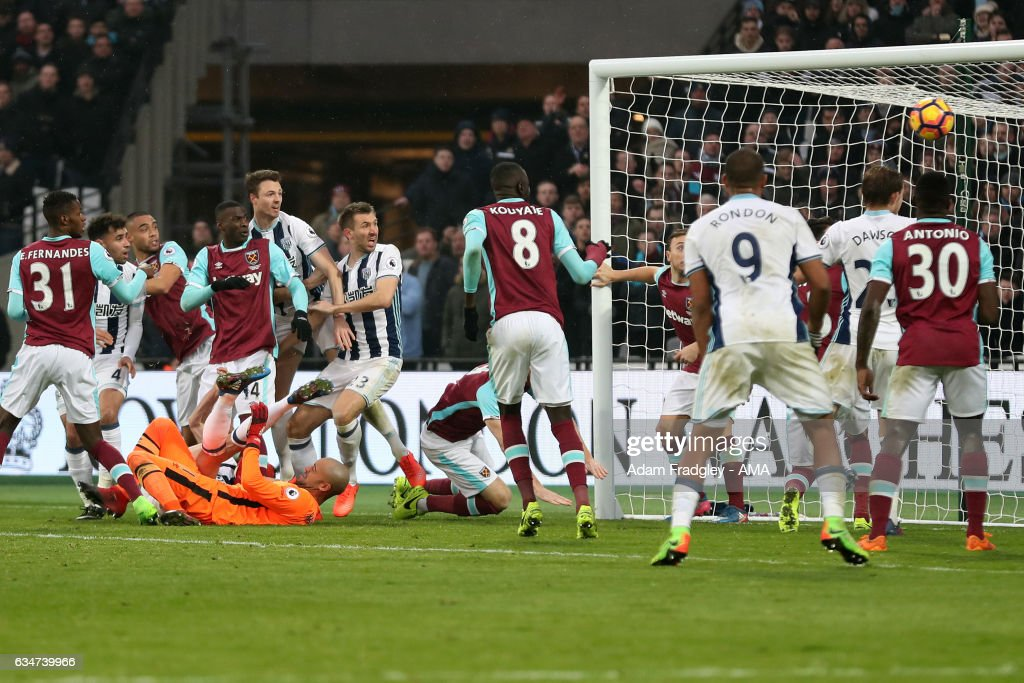 Gareth McAuley of West Bromwich Albion scores a goal to make it 2-2 during the Premier League match between West Ham United and West Bromwich Albion at London Stadium on February 11, 2017 in Stratford, England.